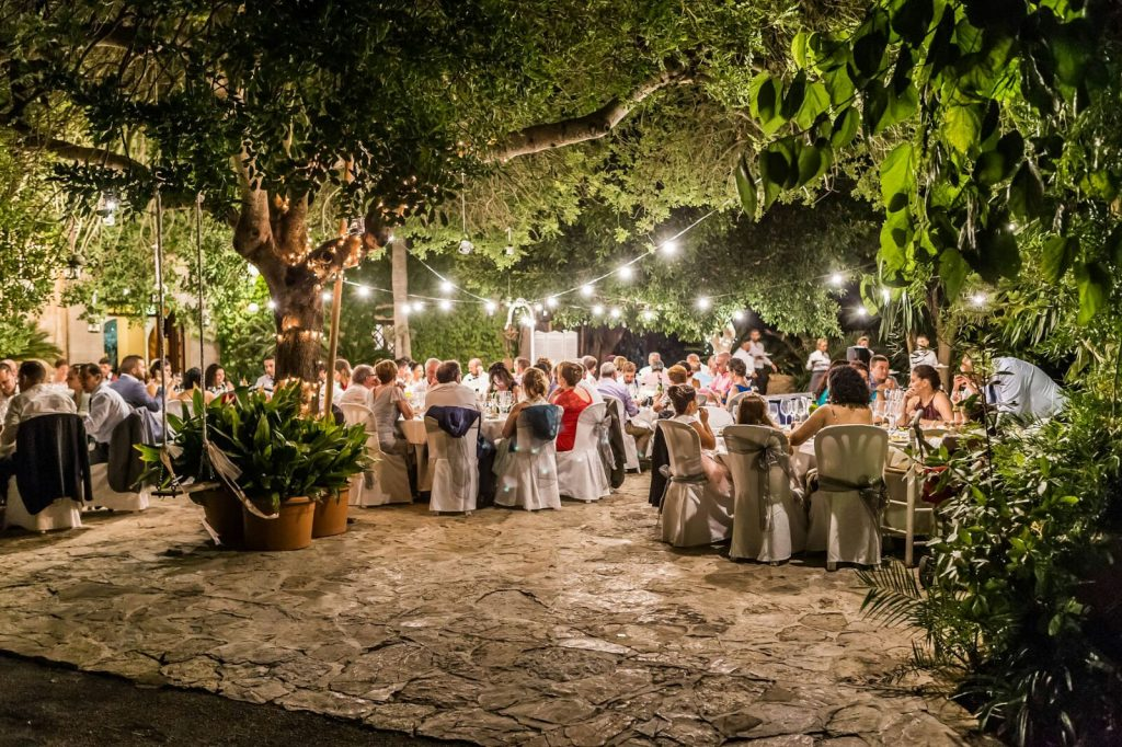 8 Tips for planning a destination wedding on a budget. Photo by Es Mitjà Fondo